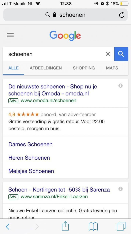 de #1 reden waarom je nooit moet stoppen met google adwords betaalde resultaten en organische resultaten mobiele weergave google